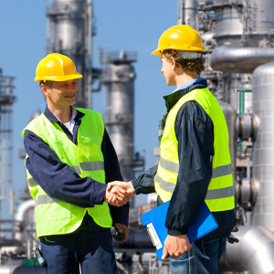 Two workers shaking hands